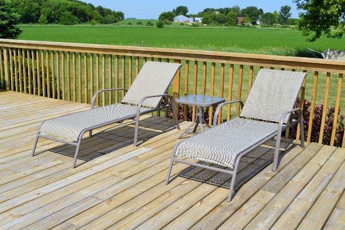 Outdoor lounge chairs with table (total of 4 chairs and 2 tables)