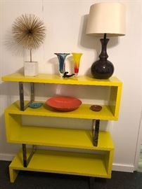 Imagine your own fun collection on this funky shelving unit!