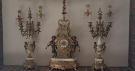 Three-piece antique clock set with candelabras