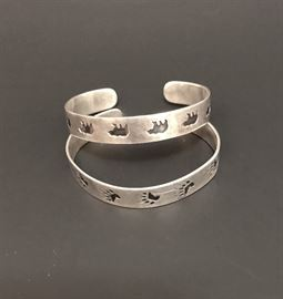 Top, Hopi sterling silver bracelet with bear design. Bottom, Hopi sterling silver bracelet with bear paw print.