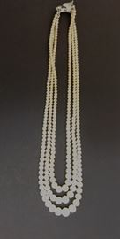 3 strand pearl necklace.