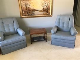 matching upholstered chairs with a nice end table