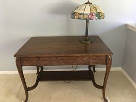 This is a beautiful early 1900's oak library table with tiffany-style lamp -- a great piece!