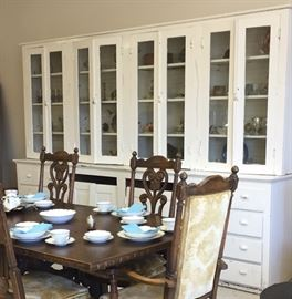 Close shot of Butler's pantry and Jamestown Lounge Co. carved chairs and china.