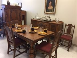 1914 Jacobean dinning room set, includes china cupboard, buffet, table and six chairs.