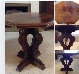Jacobean center hall or parlor table.   Has a glass top to protect book marked veneer.