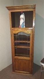 $75  Tall, oak curio cabinet