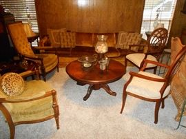 nice solid wood coffee table and living room chairs