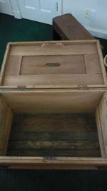 Family Room:  The trunk is now open to reveal its interior.  Note the metal plaque on the lid.