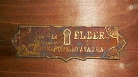 "Family Room:  This plaque is on the inside of the lid of the primitive trunk:  ""W&L ELDER, Indianapolis, Indiana, U.S.A."""