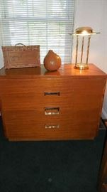"Family Room:  This mid-century four drawer chest with brass handles measures 42"" wide x 20"" deep x 33"" tall. The wine basket, gourd and vintage brass Saturn lamp are also for sale."