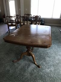 This is the table for Drexel The Pine Group. The top needs some work, but the table has three leaves and will expand to seat 10 comfortably (12 if two share each end). This is a terrific table for large families.