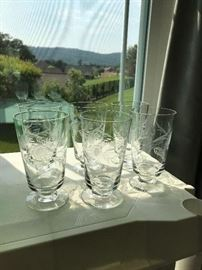 Six engraved footed crystal water/tea glasses.
