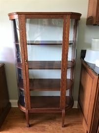 Antique curio cabinet. Original glass in front and one side, plexiglass in one side.