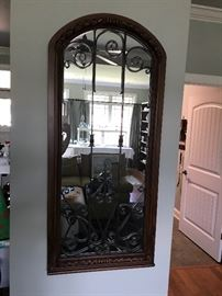 Gorgeous wrought iron and wood mirror.