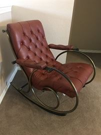 Unique MCM style rocking  chair that is actually similar to one from 1890. This one is in excellent condition. Very clean leather -in pristine condition. Made by Lee L. Woodard in Michigan.