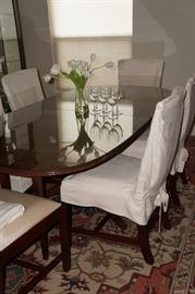 Beautiful dining table with 10, YES 10 chairs.  8 side chairs and 2 arms chairs.  Can be round, oval or even larger oval with leaf added.