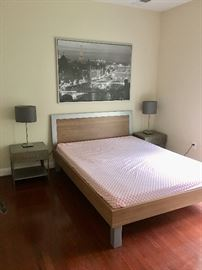 Queen size bed and mattress.  Side tables, lamps