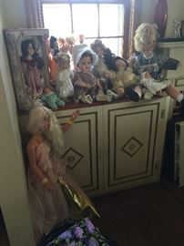 Some of the dolls.  They're on cabinets that are on each side of the fireplace.  See the BIG Barbie?  There are also some really pretty older dolls and a Shirley Temple.