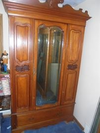 Vintage Armoire. Beveled mirror and bottom drawer. (Excellent shape)