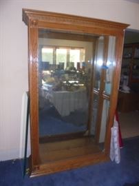 Very large display case. Front glass door slides to insert glass shelves.