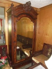 Antique Armoire imported from Europe. Beveled mirror and a bottom drawer.