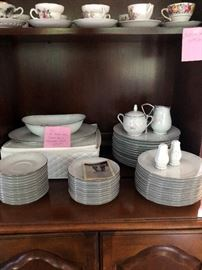 Fine china serving for 12 with serving pieces