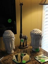 2 more Oriental head statues with metal giraffe.