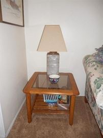 pair of side tables with beveled  glass, and lower shelf, in nice condition. Pair of ceramic lamps matching