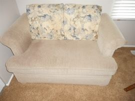 sleeper loveseat (twin) size.  We also have a memory foam mattress cover in size: twin available
