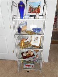 Metal and glass shelf unit with More Asian Art works and collectibles from Japan