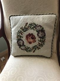 One of many needle work pillows