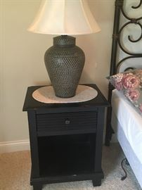 There are a pair of  these black bedside tables