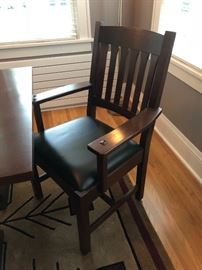 Two Stickley Cottage arm chairs with Córdoba Black leather seats