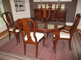 "Drexel Dining table 64"" long up to 100"" when two 18"" leaves are utilized.  Paired with 8 Bernhardt chairs.  Two Captains and 6 side chairs.  This photo shows table at 64"" long."