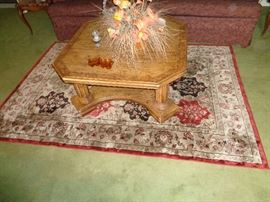 large coffee table and silk rug