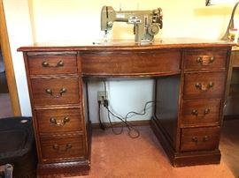 Necchi sewing machine hides in mahogany desk.