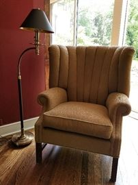 Camel Upholstered Wing Chair37w x 36d x 44h (21h) Chapman brass floor lamp with black shade55h x 22w