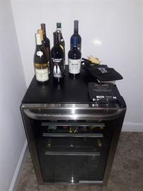 Frigidaire wine fridge and bottles...