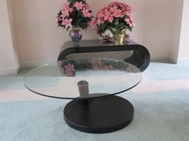 Two coffee tables. In the forefront: 360 degree swivel.   A MUST SEE!!!