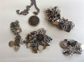 Charm bracelets--four total, some silver charms