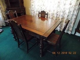 diningroom set (2 more chairs present, but need repair) (part of diningroom set - this table, buffet, blind china cabinet and chairs for $550.00)