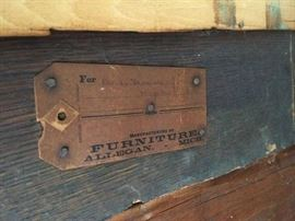 Tag on back of antique secretary.