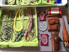 Selection of knives, Swarovski crystal, and costume jewelry among the many smalls for sale.