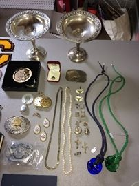 Two Gorham No. 1140 weighted sterling compotes; two signed Baccarat crystal pendants; sterling Catholic icons; sterling baby rattle; other interesting smalls.