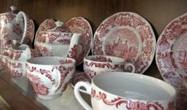 "Some of the pieces of Wedgwood ""Royal Homes of Britain"" red transferware luncheon set"