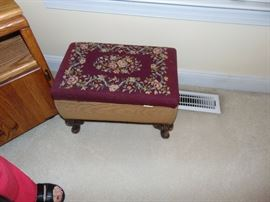 One of two vintage embroidered footstools