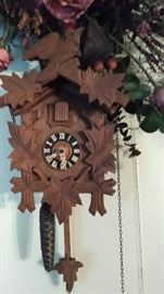 Coo coo clock with bird on top