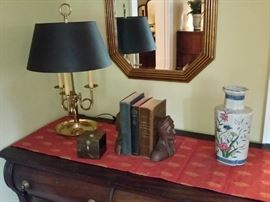 Tablescape view showing hard to find, antique Indian matching book-ends.  Octagonal beveled mirror