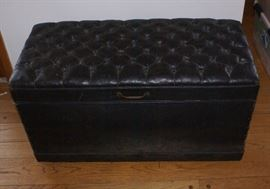 Tufted Black Leather Antique Trunk with Pink Fabric Insert.